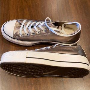 Gold Converse tennis shoes